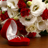 Wedding rings, gift box and flowers for  bride. Stock Image