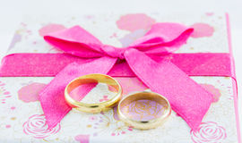 Wedding rings on gift box Stock Photography