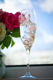 Wedding rings in a glass with champagne Stock Photo
