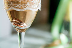 Wedding rings in a glass of champagne. Close up. Royalty Free Stock Photo
