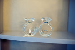 Wedding rings in a glass figurines Royalty Free Stock Image