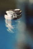 Wedding Rings on Glass Table Stock Photo