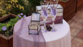 Wedding rings and glasses of champagne on the wedding ceremony. stock video footage