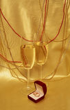 Wedding rings and glasses with sparkling wine Stock Photos