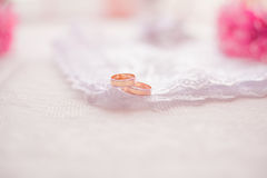 Wedding rings. Gold wedding rings on lace Stock Photo