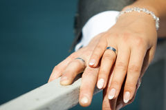 Wedding rings gold outdoors. Two Royalty Free Stock Image