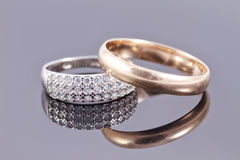 Wedding rings. Gold and silver with precious stones Royalty Free Stock Photo
