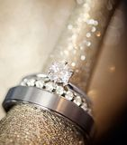 Wedding rings on gold Stock Photos