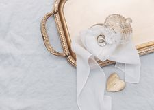 Wedding rings on gold tray, stock photo