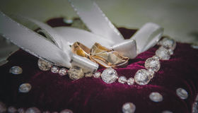 Wedding rings, gold on the white Stock Images