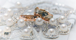 Wedding rings, gold on the white Stock Photography