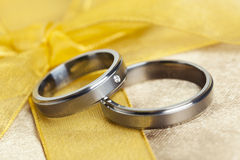 Wedding Rings on golden bow Royalty Free Stock Photos