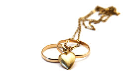 Wedding rings and golden heart Royalty Free Stock Photo