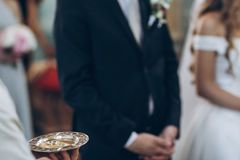Wedding rings on golden plate in church. holy matrimony. wedding. Ceremony concept Royalty Free Stock Image
