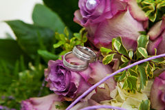 Wedding rings golden white purple Stock Photo