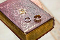 Wedding rings on a gospel Stock Photos
