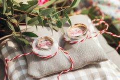 Wedding rings on the gray cushion Stock Photos