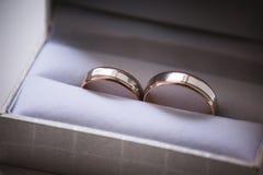 Wedding rings in grey box Stock Photos