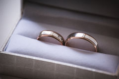 Wedding rings in grey box Royalty Free Stock Photography