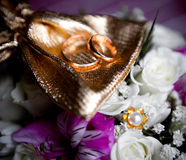 Wedding rings of the groom and the bride on a bunc Royalty Free Stock Photo