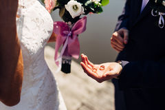 Wedding rings. The groom holding a wedding rings stock image