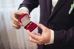 Wedding rings in groom's hand Stock Photo