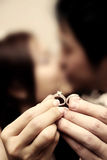 Wedding rings on hand of bride and groom Stock Photo