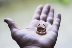 Wedding rings in hand Stock Photos