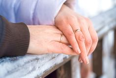 Wedding rings on hand stock photography