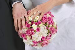 Wedding rings, hand and flowers in the wedding photo Stock Photography