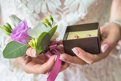 Wedding rings in hand. wedding rings in the hands of the bride. Stock Photos