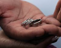 Wedding rings in hands. A just married couple holding the rings of matrimony Royalty Free Stock Photo