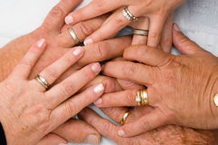 Wedding Rings on hands. Wedding Rings on Six Hands royalty free stock images