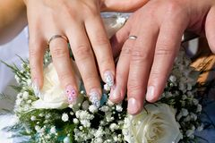 Wedding. Rings, hands and bouquet stock photos