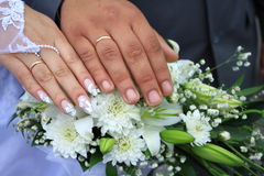 Wedding. Rings, hands and bouquet stock image