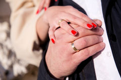 Wedding rings and hands. Bride and groom hands with wedding rings Stock Image