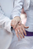 Wedding rings and hands. Bride and groom, wedding rings and hands Stock Photo