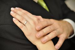 Wedding rings. The hands of the bride and the groom with the wedding rings in their fingers Stock Image
