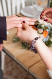 Wedding rings and hands of bride and groom. young wedding couple at ceremony. matrimony. man and woman in love. two happy people c Royalty Free Stock Image