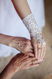 Wedding rings on hands of bride, mother and grandmother Stock Photo