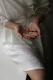Wedding rings in the hands of the bride. In a white dressing gown Royalty Free Stock Photo