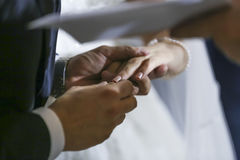Wedding rings on hands during celebration Stock Image