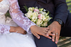 Wedding rings and hands Stock Photography