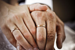 Wedding rings and hands Royalty Free Stock Photo