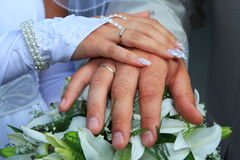 Wedding rings and hands Royalty Free Stock Image