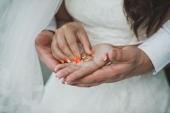 Wedding rings in hands of the newly-married couple 1932. Royalty Free Stock Photography