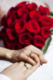 Wedding rings on hands of newlyweds Royalty Free Stock Photos