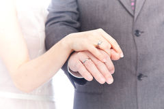 Wedding rings on hands of the newlyweds. Royalty Free Stock Photography