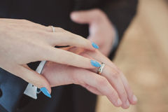 Wedding rings on hands of the newlyweds. Royalty Free Stock Image