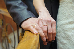 Wedding rings on the hands Stock Photo